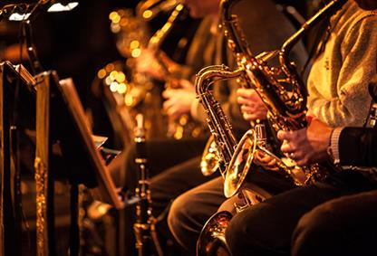 Group of people playing saxophone