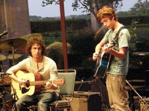 Two boys playing guitars